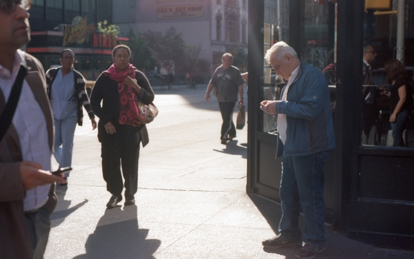 Light and people converge at 57th street and 7th avenue